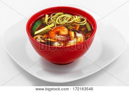 Seafood soup, paprika, zucchini, carrots, seafood, white background