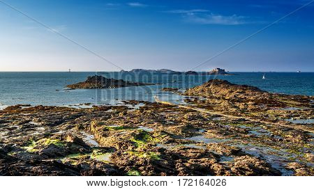 Rocky beach. landscape photo: sunset at the coast of Dinard in Brittany (France).