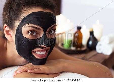 Young Beautiful Woman In A Mask For The Face Of The Therapeutic Black Mud.spa
