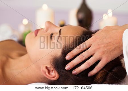 Facial Massage. Pretty Woman Relaxing In The Beauty Treatment.