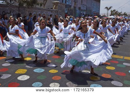 ARICA, CHILE - FEBRUARY 10, 2017: Group of dancers of Africa descent (Afrodescendiente) performing at the annual Carnaval Andino con la Fuerza del Sol in Arica, Chile.