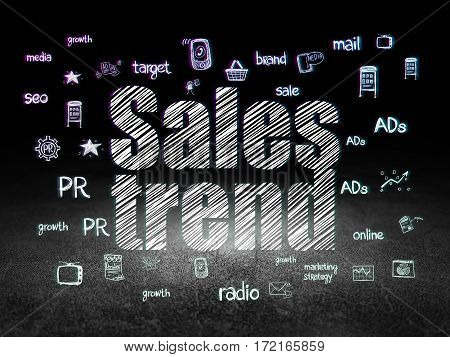 Marketing concept: Glowing text Sales Trend,  Hand Drawn Marketing Icons in grunge dark room with Dirty Floor, black background
