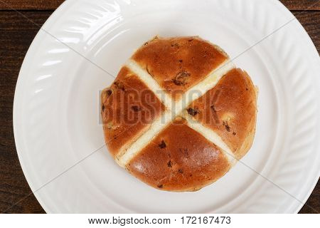 top view of hot cross bun with raisins