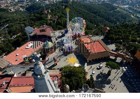 Barcelona Spain - December 2 2016: Aerial view of buildings on to of Tibidabo mountain in Barcelona Spain. Unidentified people visible