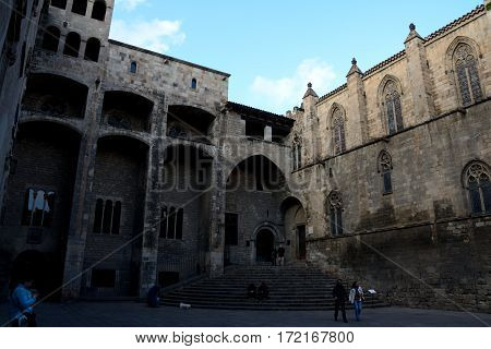 Barcelona Spain - December 3 2016: Buildings on Buildings on Placa del Rei square in Barcelona city Spain. Unidentified people visible.