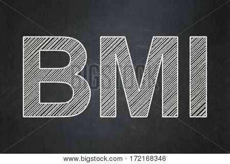 Healthcare concept: text BMI on Black chalkboard background