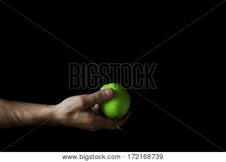 Green Apple In A Man's Hand