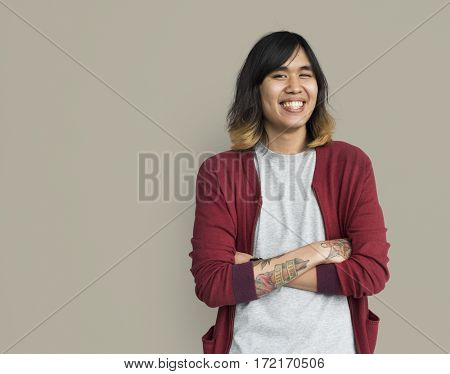 Young asian guy crossed arms smiling portrait