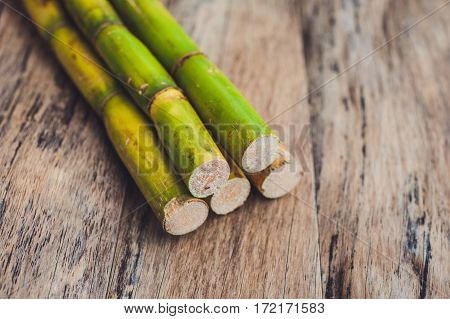 Stalks Of Sugar Cane On The Old Wooden Background
