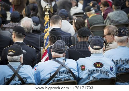 NEW YORK - 11 NOV 2016: Korean War vets attend the opening ceremony in Madison Square Park before the annual parade up 5th Avenue on Veterans Day in Manhattan.