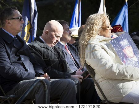 NEW YORK - 11 NOV 2016: NYPD Police Commissioner James O'Neill and other VIPs on stage at the ceremony in Madison Square Park before the annual Americas Parade up 5th Ave on Veterans Day in Manhattan.