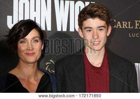 LOS ANGELES - JAN 30:  Carrie-Anne Moss, Owen Roy at the