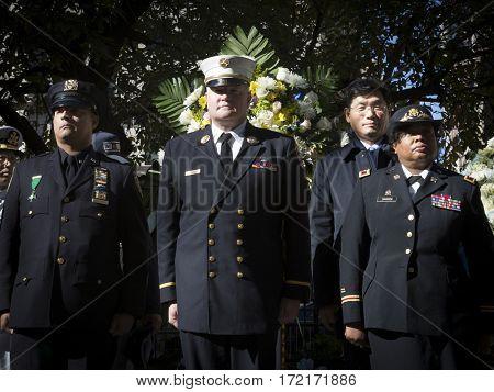 NEW YORK - 11 NOV 2016: 2016 Grand Marshals Stephanie Dawson, Joseph Duggan Jr., and Nelson Vergara at the Eternal Light Monument wreath laying ceremony in Madison Square Park on Veterans Day.