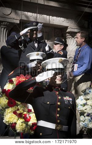 NEW YORK - 11 NOV 2016: Members of the NYFD and USMC at the Eternal Light Monument for the wreath laying ceremony in Madison Square Park before the annual Americas Parade on Veterans Day in Manhattan.