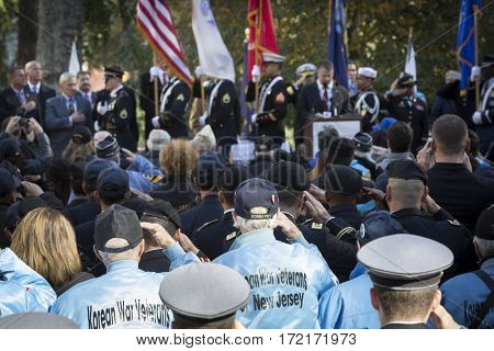 NEW YORK - 11 NOV 2016: Korean War vets salute the flags of the honor guard at the opening ceremony in Madison Square Park before the annual parade up 5th Avenue on Veterans Day in Manhattan.