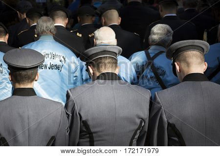 NEW YORK - 11 NOV 2016: West Point Military Academy cadets bow their heads during the opening ceremony in Madison Square Park before the annual parade up 5th Avenue on Veterans Day in Manhattan.