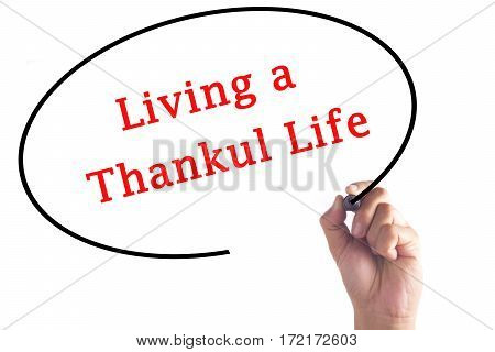 Hand Writing Living A Thankful Life On Transparent Board
