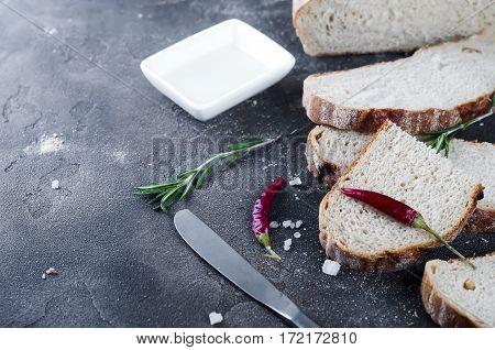 Sliced bread Ciabatta and extra virgin Olive oil on dark concrete background