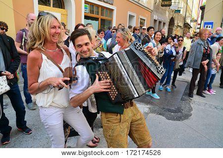 Salzburg Austria - April 25 2015: a street performer with his accordion entertaining the tourists in salzburg city center austria. shot taken on april 25th 2015