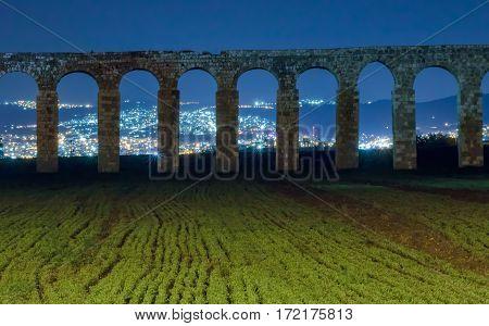 Remains of an ancient Roman aqueduct between Acre and Nahariya at night