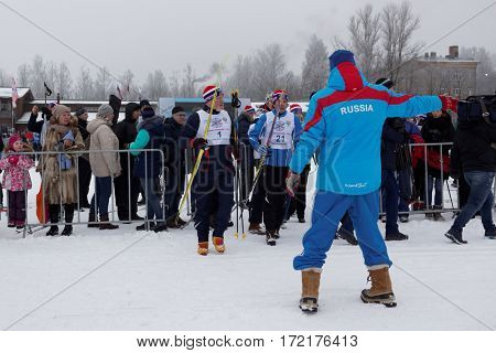 ST. PETERSBURG, RUSSIA - FEBRUARY 11, 2017: Vice-governor of St. Petersburg Vladimir Kirillov go to the start of Ski Track of Russia. This mass ski race is held annually since 1982