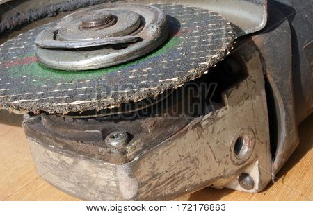 Used grinder disc, industrial tool in work