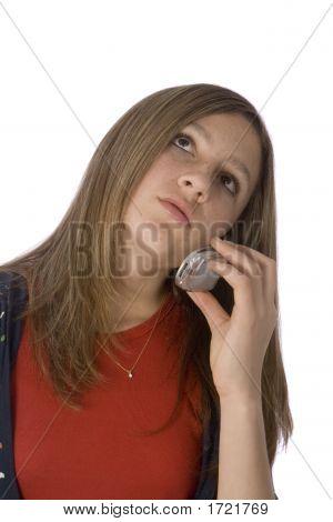 Teen Girl On Cell Phone Looking Upward