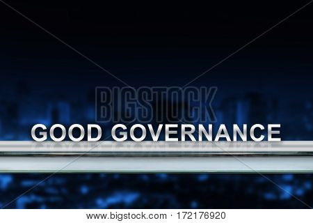 good governance on metal railing with blurred background