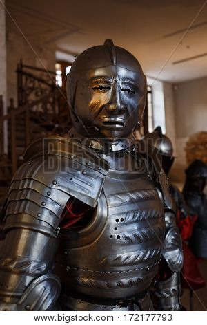Armor European Knight near 15-17 centuries. Knight's helmet looks into the camera.