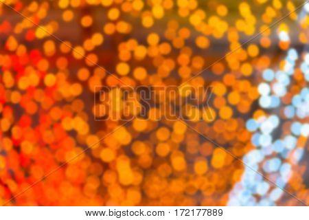 Abstract circular natural orange and yellow light bokeh background