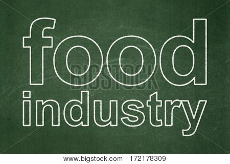 Manufacuring concept: text Food Industry on Green chalkboard background