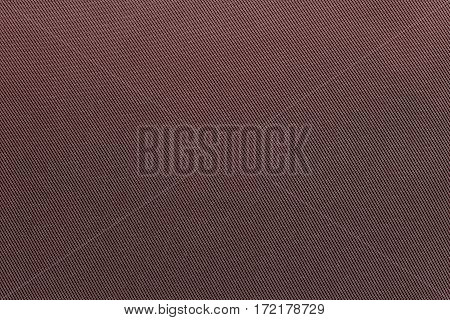 the textured background of fabric or textile material of dark red color