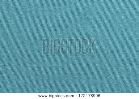 the textured background of cotton fabric or textile material of pale blue color