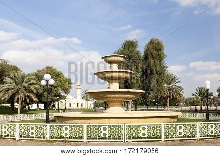 Fountain and mosque at the Hili archaeological park in Al Ain. Emirate of Abu Dhabi United Arab Emirates