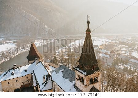 Aerial view of Oravsky Podzamok from Orava Castle in Slovakia. Old medieval tower. Beautiful winter landscape with sunshine.