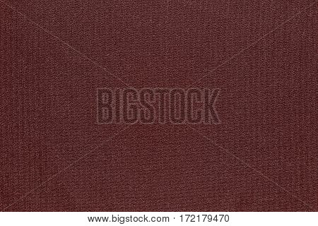 abstract texture and background of textile material or fabric of dark red color