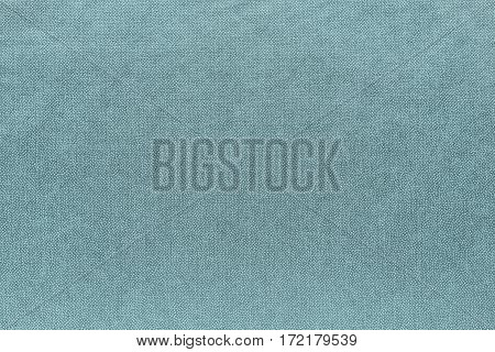 abstract background and speckled or mottled texture of fabric or textile material of pale turquoise color