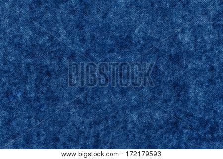 abstract background and texture of soft fabric or textile material of dark blue color