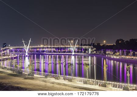 New bridge over the Dubai Water Canal illuminated at night. United Arab Emirates Middle East