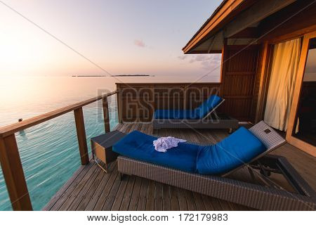 Beautiful tropical Maldives resort hotel and island with beach and sea on sky sunset for holiday vacation background concept - Boost up color Processing.