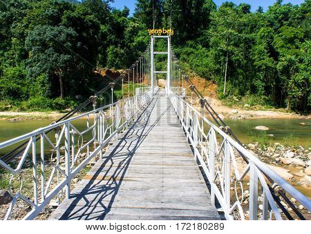 Yang Waterfall Bay, Vietnam. Hinged Pedestrian Bridge Over The River. Reserve