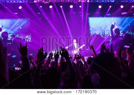 Crowd enjoying concert happy people jumping large group celebrating new year holiday party background fun concept blurred