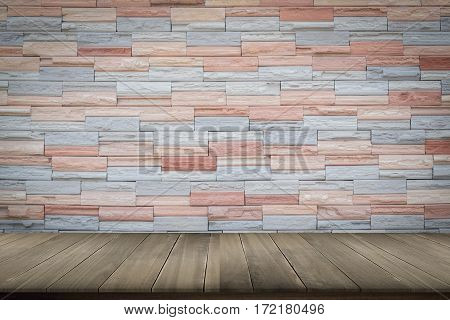 Wooden floor with modern brick wall for background.