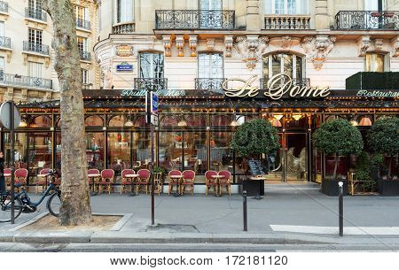 paris France-February 15 2017 : The famous restaurant Le Dome on Montparnasse boulevard in Paris. Opened in 1898 it was frequented by famous sculptors writers and painters...
