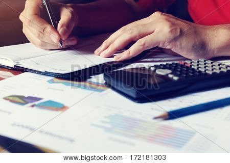 Woman Doing Finance And Writing Make Note With Calculate About Cost At Home Office.