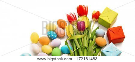Easter decoration with tulips and eggs on white background