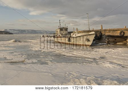 Old ship in the ice of Lake Baikal