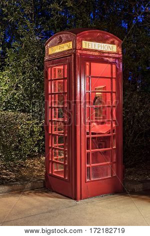 Vintage Red Telephone Booth In Early Evening Light
