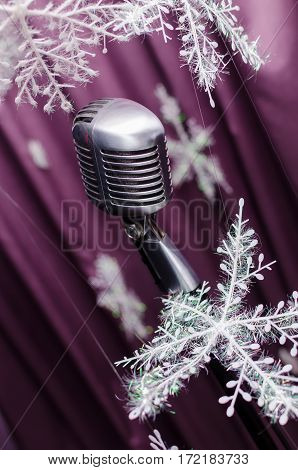 Microphone on the violet background in new year. Retro microphone. A microphone on stage.