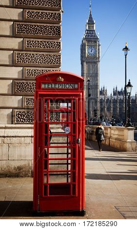 red phone box and Big Ben in London, UK